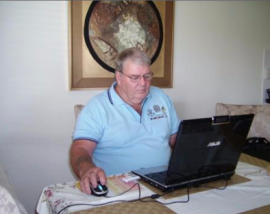 John Weir (veteran) at his laptop