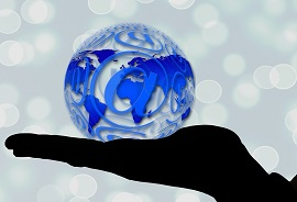 Hand holding a globe with email