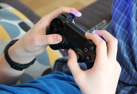 Kid's hands playing video games